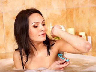 Woman shaving her body.