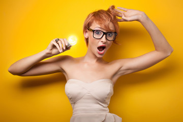Surprised woman with light bulb