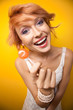 Smiling woman showing lollipop
