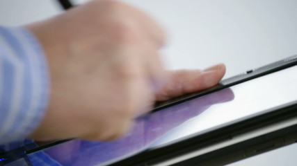 male hands using a stylus pen on tablet computer