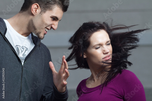 Young woman gets slapped by her boyfriend.Action shot