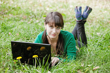 beautiful  sexy girl relaxing with laptop