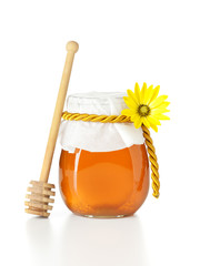 honey jar with wooden dripper