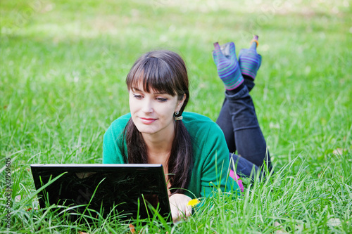 Active beautiful young  girl relaxing with laptop