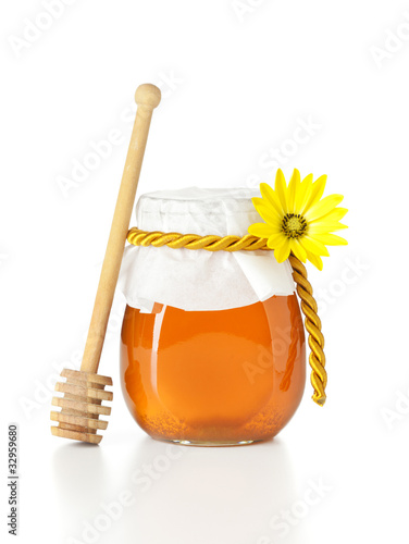 honey jar with wooden dripper
