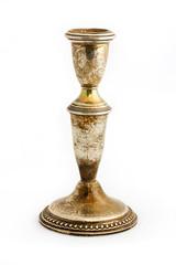 Old tarnished candlestick holder