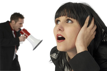 Woman Covering Ears Man Yelling in Bullhorn