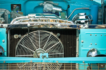 engine bay and radiator grille of an classic old american car