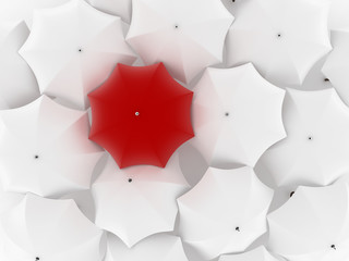 One unique red umbrella, among other white