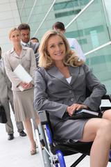 Successful businesswoman in wheelchair