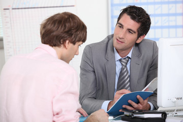 Tutor advising his student