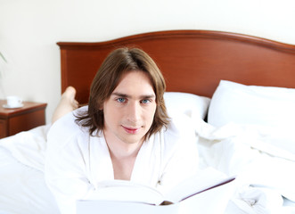 portrait of a young man in bed