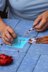 Process of lace-making with bobbins