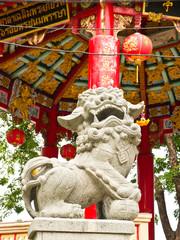Stone lion and Chinese pavillion