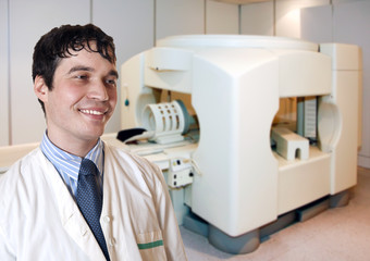 A portrait of doctor next to CT scanner