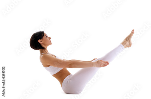 Young woman training yoga - fish pose isolated