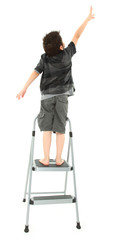 Child on Step Ladder Reaching Up