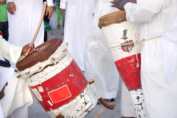 Colorful traditonal drums played by artists with pearl song