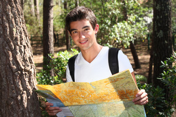 young man holding a map