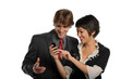 Couple looking at a  cell phone and smiling