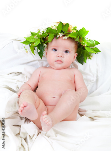 baby with red hair with a crown of jasmine