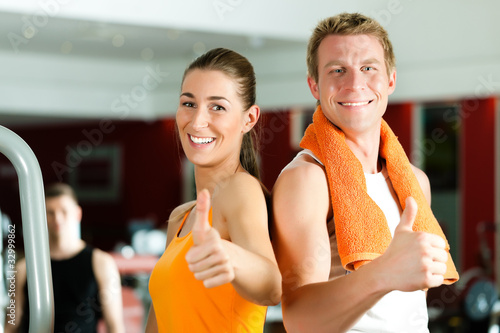 Sportive couple in gym