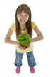 Cute Young Girl Holding Plant