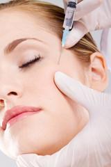 woman receiving face botox