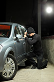Thief wearing a robbery mask trying to steal a car poster