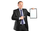 Young smiling businessperson pointing to a blank clipboard