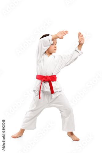 Karate boy exercising