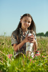 teen girl  in meadow grass
