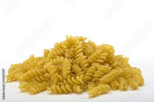Raw spiral pasta noodles in a pile