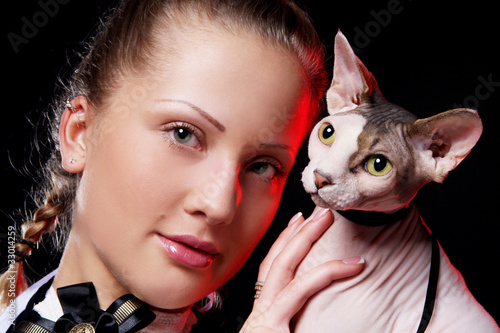 Woman with sphynx cat
