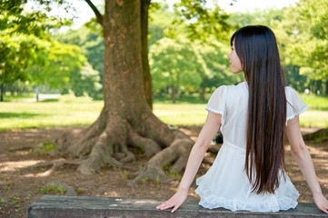 beautiful asian woman sitting on the bench