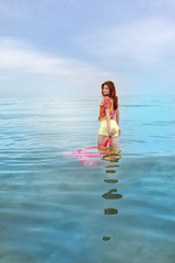 Beautiful sensual woman dreaming in the sea
