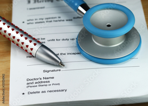 A Blue Stethoscope On A Doctors Desk