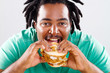closeup of african american man eating burger