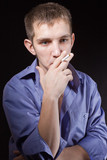 Portrait guy smokes in studio