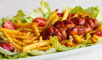 chicken pastrami served with french fries and fresh vegetables