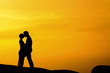 Kissing in sunset