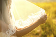 Bride under veil.