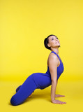 positive woman exercise yoga pose