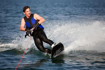 sliding wakeboarder  in water splash