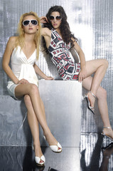 beautiful women in sunglass on shot in studio