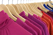 Line of colorful clothing on hanger