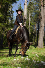 Happy cowgirl on brown horse
