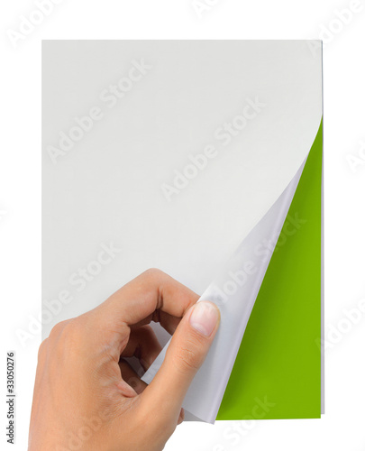 hand turn page of magazine isolated on white
