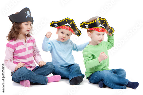 Children playing game in kids party pirate hats