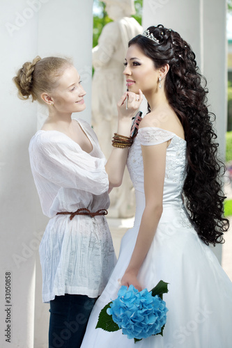 Stylist takes care of the bride